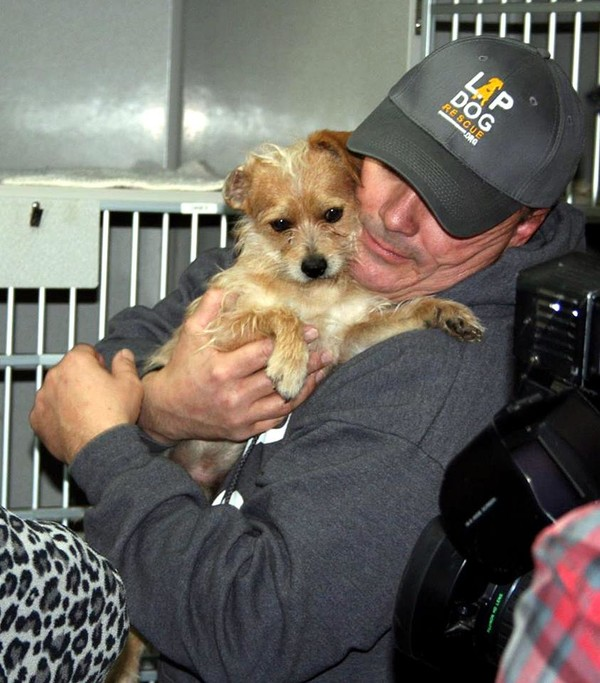 Valencia County Rescue Brian Spence holding rescued dog